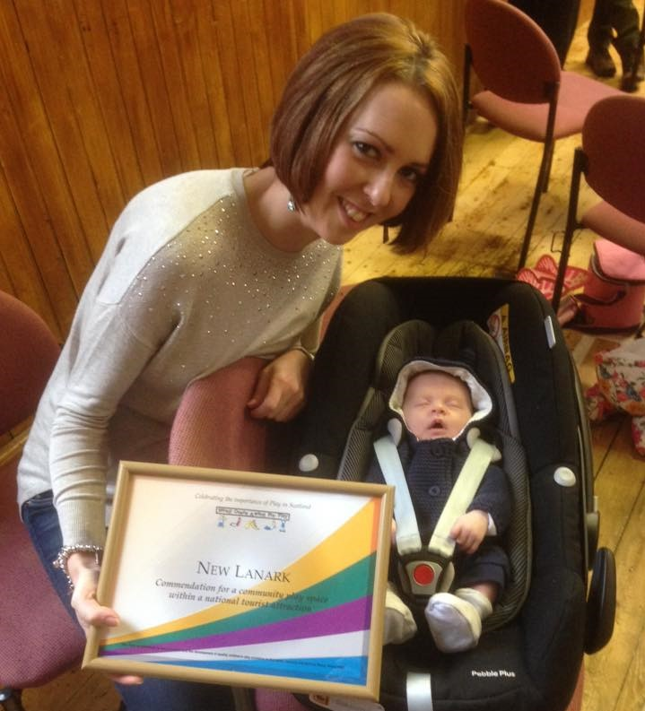 Jane Masters, Heritage Manager at New Lanark World Heritage Site collects the award with one of Clearburn's newest fans