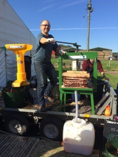 Duncan demonstrates the new apple pressing equipment
