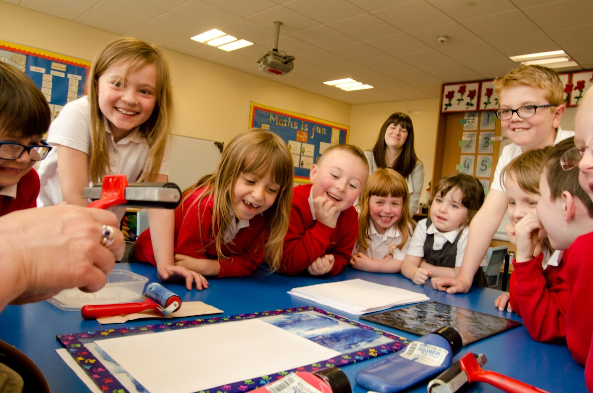 School pupils learn printing techniques ahead of planning the stained glass panels