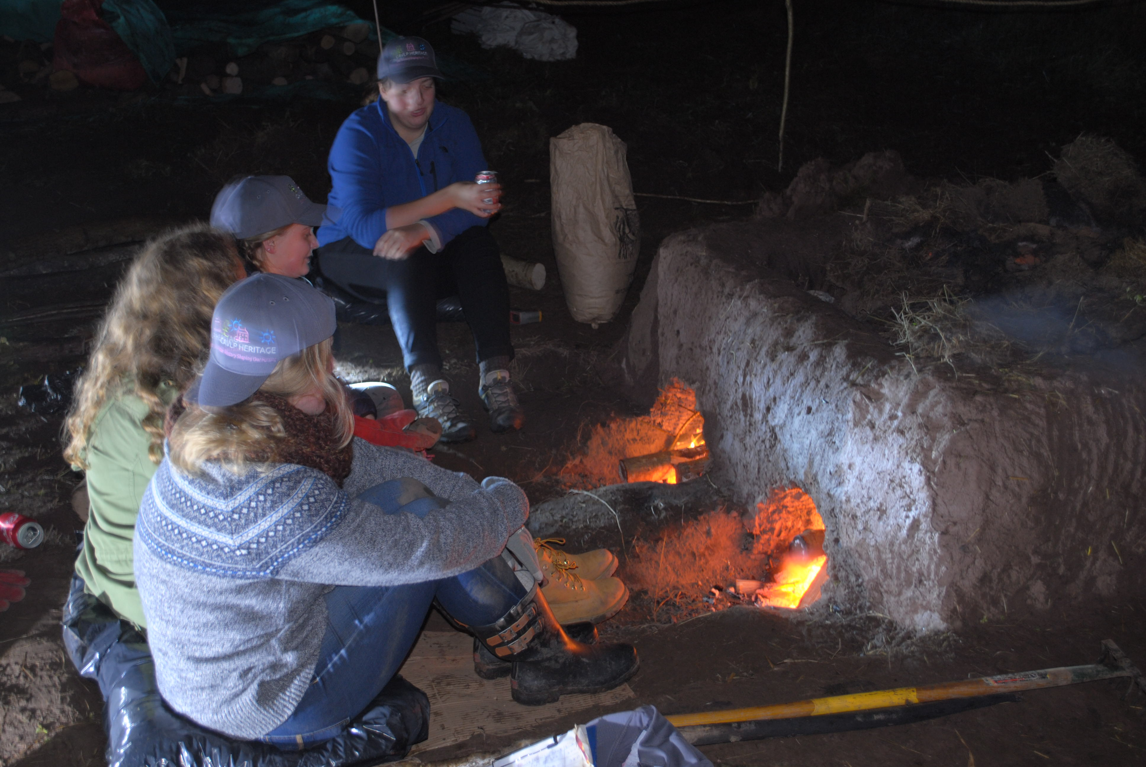 Volunteers keeping the tile kiln fire stoked late into the night