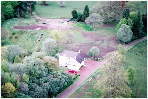 The Dairy / Gardener's Cottage was extended as a residence after Milton Lockhart House was abandoned and subsequently removed. The disturbed ground in this photo of the 1990s is the site of both the old (removed) Milton Lockhart House and the current Lockhart Castle.